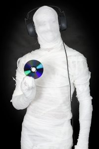 bigstock-Man-In-Bandage-With-Ear-phones-4516497